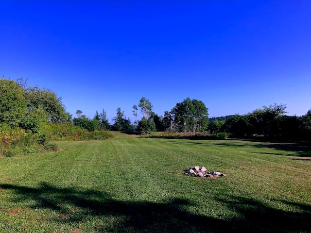 Surrounded by wildflowers and our very own apple orchard, enjoy the firepit with plenty of room to play Ultimate Frisbee.