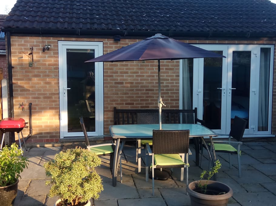 Your own outdoor seating area with BBQ and patio set.