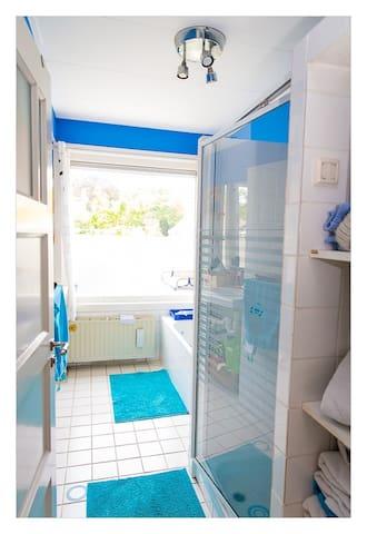 Bathroom on 1st floor with bath and shower