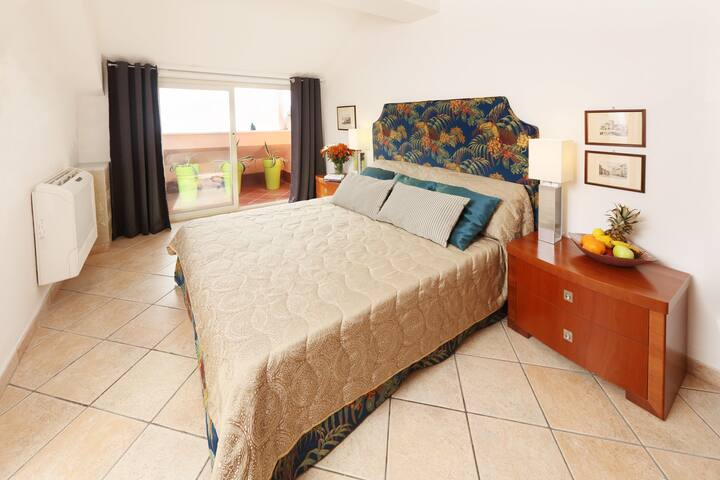 double bed room nr. 1 with views on the coast line of Calabria and the old town of Taormina
