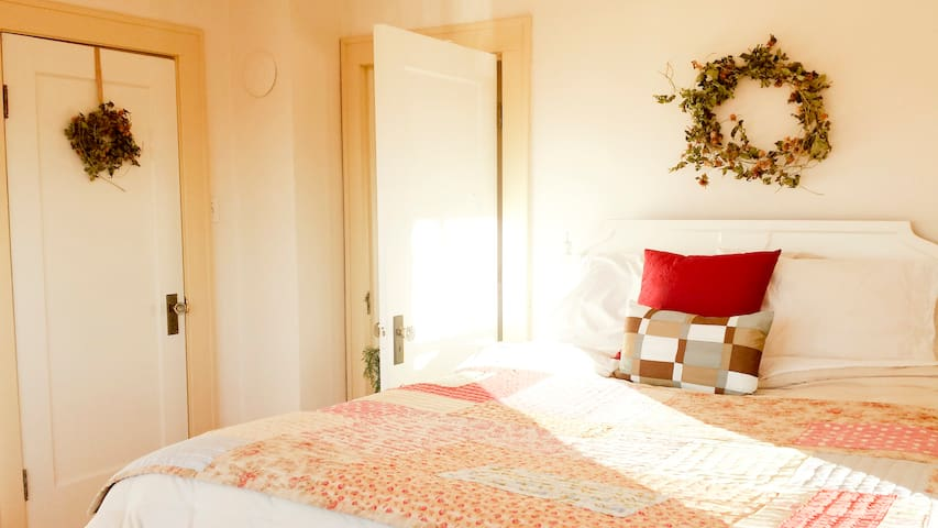 Southeast bedroom--features morning light and views of the pasture and horse