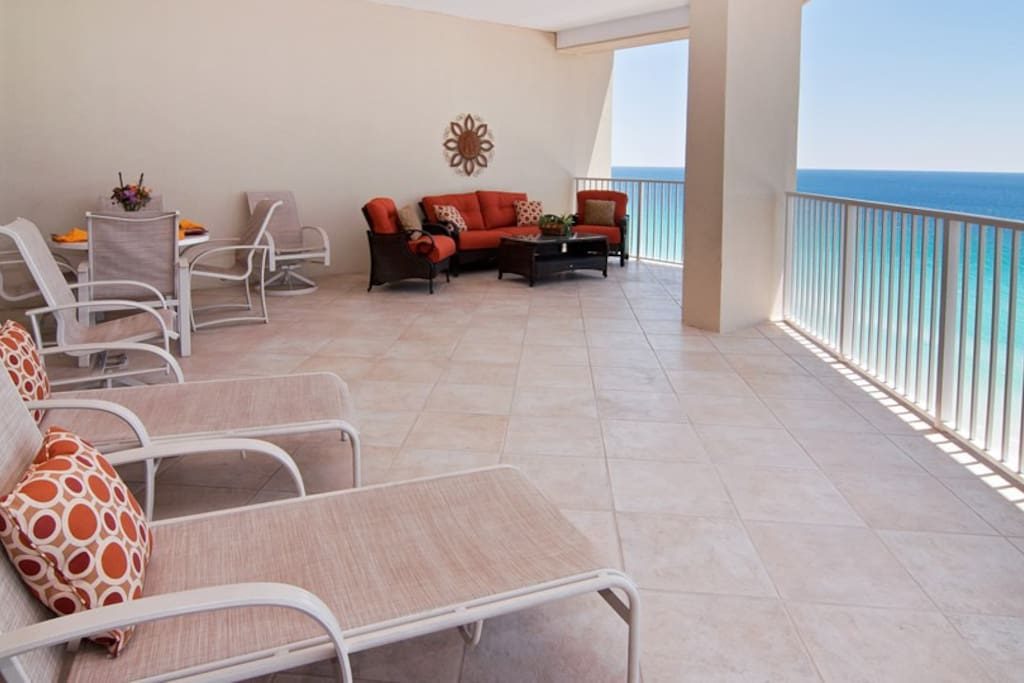Enjoy the spacious 475 sq ft balcony w areas for dining, lounging or comfy seating