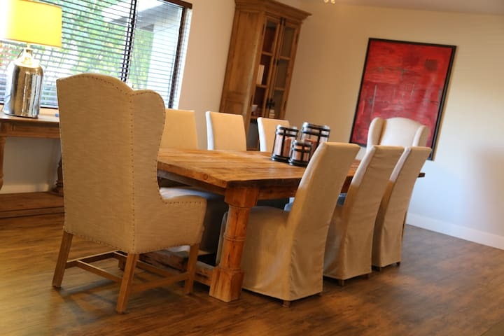 spacious dining room sits eight