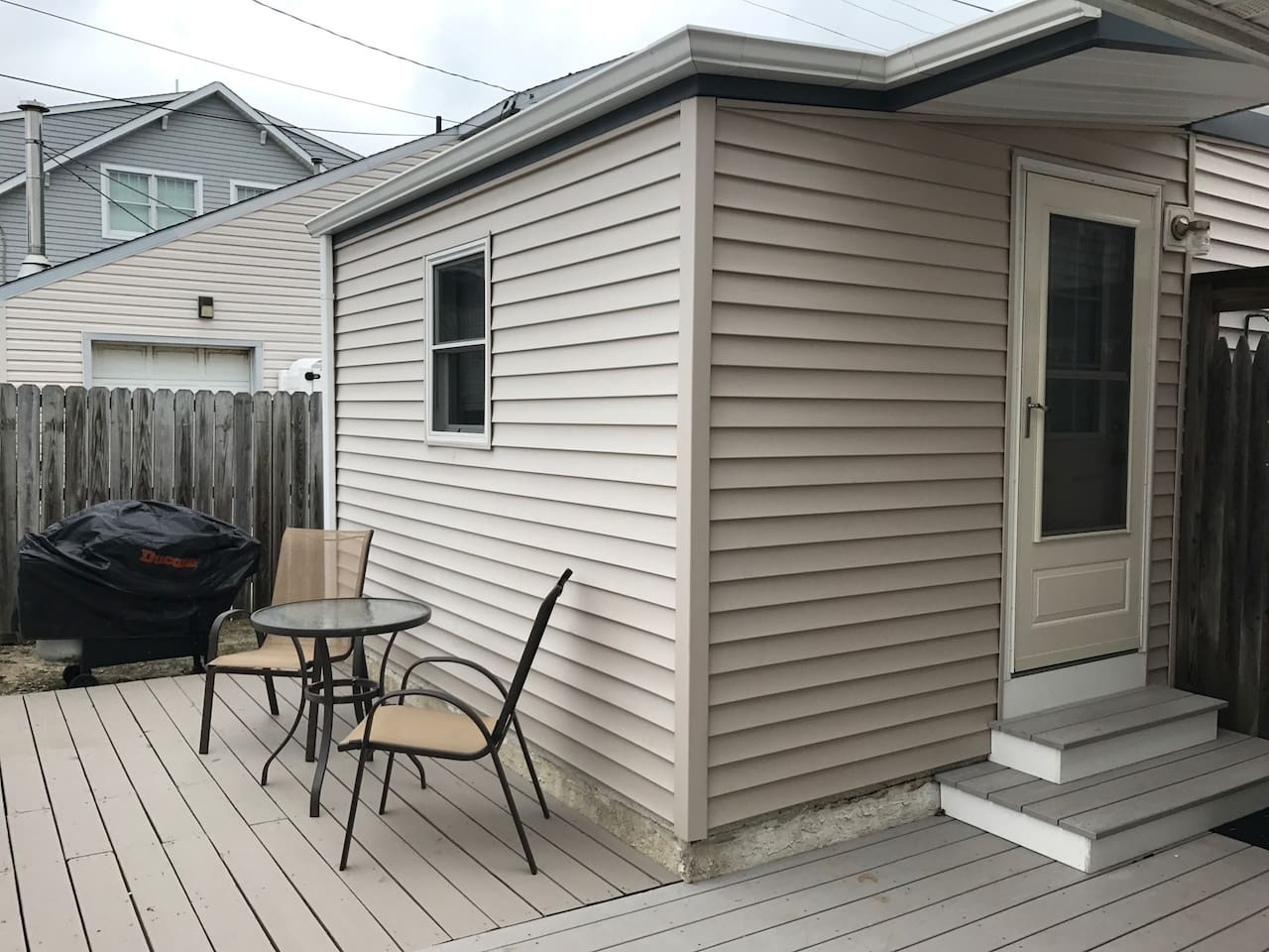 Relax on our back deck with patio seating and gas BBQ