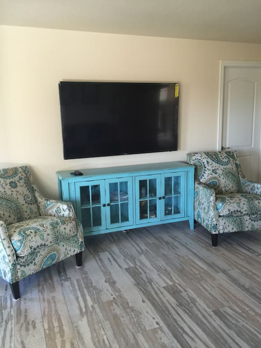 65 inch TV with cable and HD channels for you to enjoy your favorite shows.
