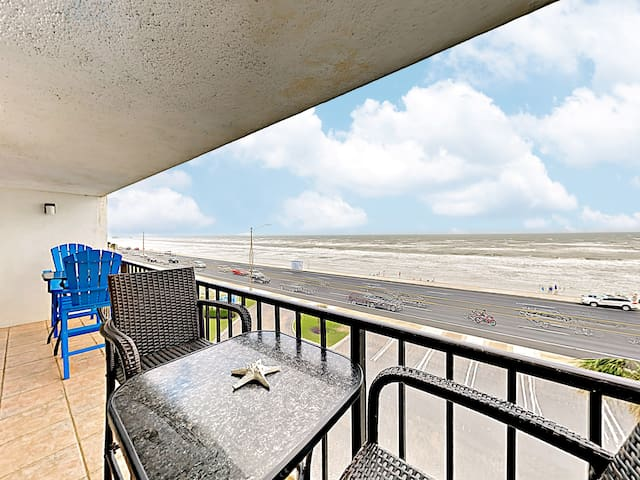 Step out to a private balcony with a great beach panorama.