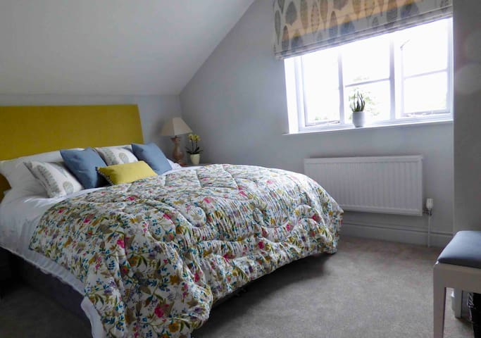 Bedroom 1 with king size double bed and Voyage designer fabrics.