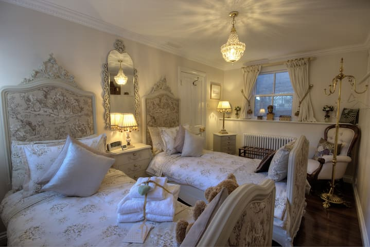 Bedroom 3 - French-inspired twin room with a pair of ornate beds