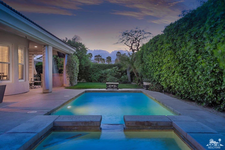 Backyard with spa and pool.