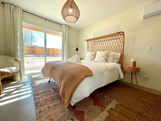 Master bedroom with breathtaking views of the mountains.