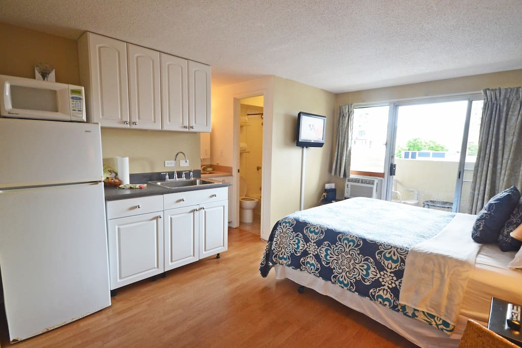 Kitchenette has a sink, refrigerator, microwave, coffee pot, tea kettle & a hot plate for lite cooking.