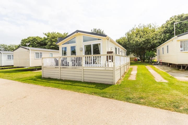 Luxury lodge for hire at Broadland sands holiday park with decking ref 20349