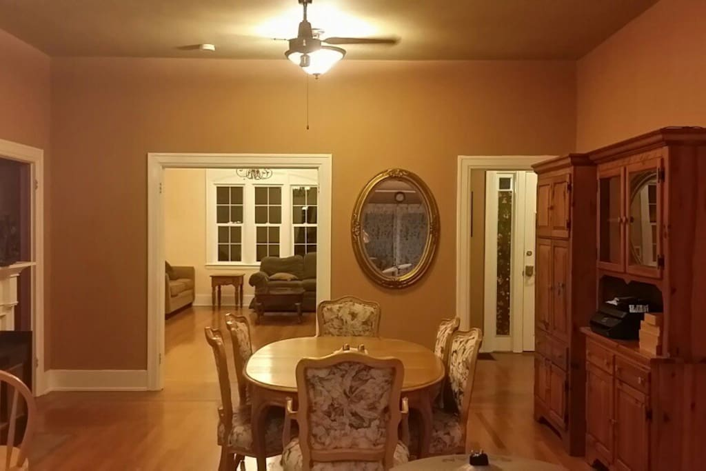 Enjoy your meals in this spacious dining area.  The whole downstairs of this home built in 1920 boasts 10 foot ceilings.
