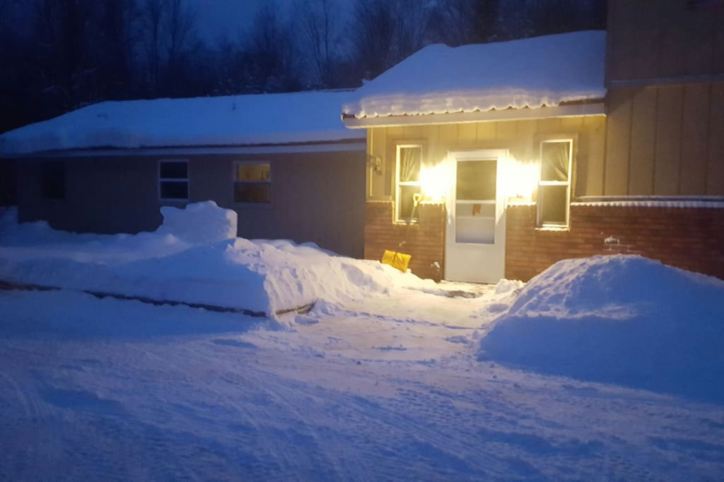 Well lit, and plowed, entry way.