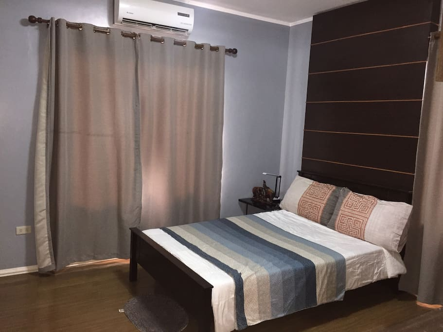 Couple bedroom with TV sets