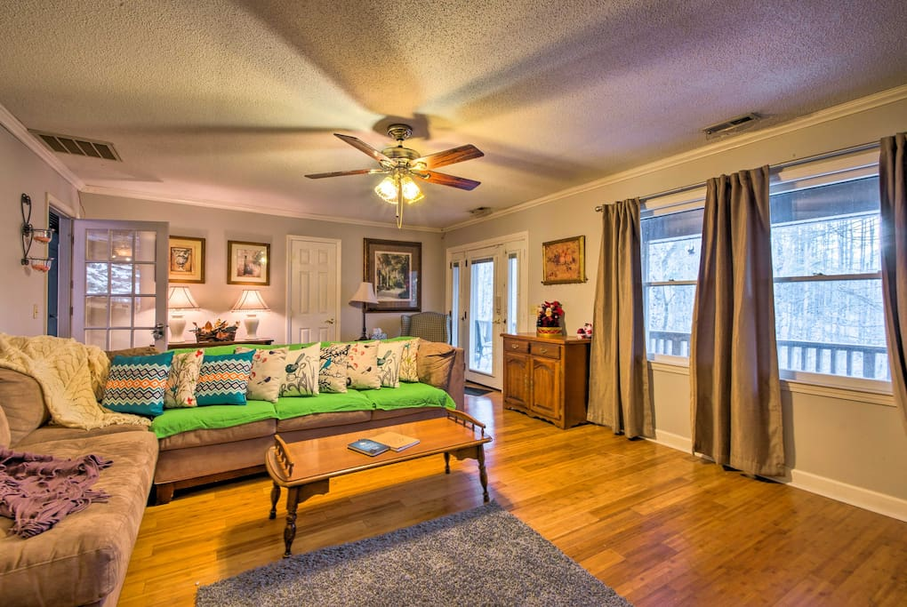 This 4-bed, 3-bath vacation rental house features several large living areas.