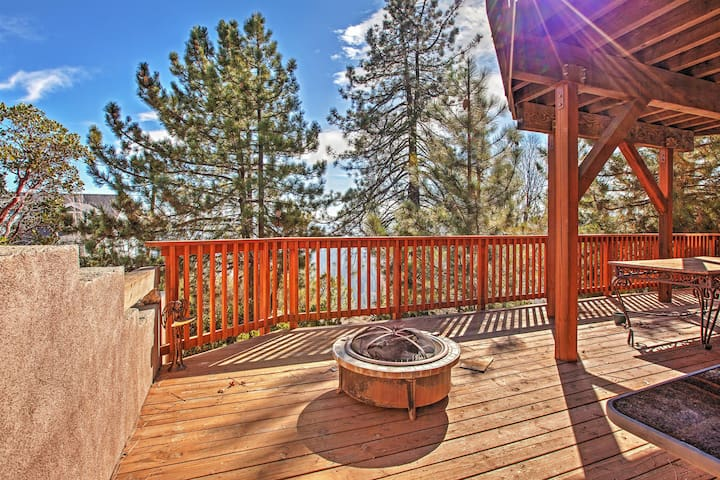 Relax on the deck at this Lake Arrowhead vacation rental house!