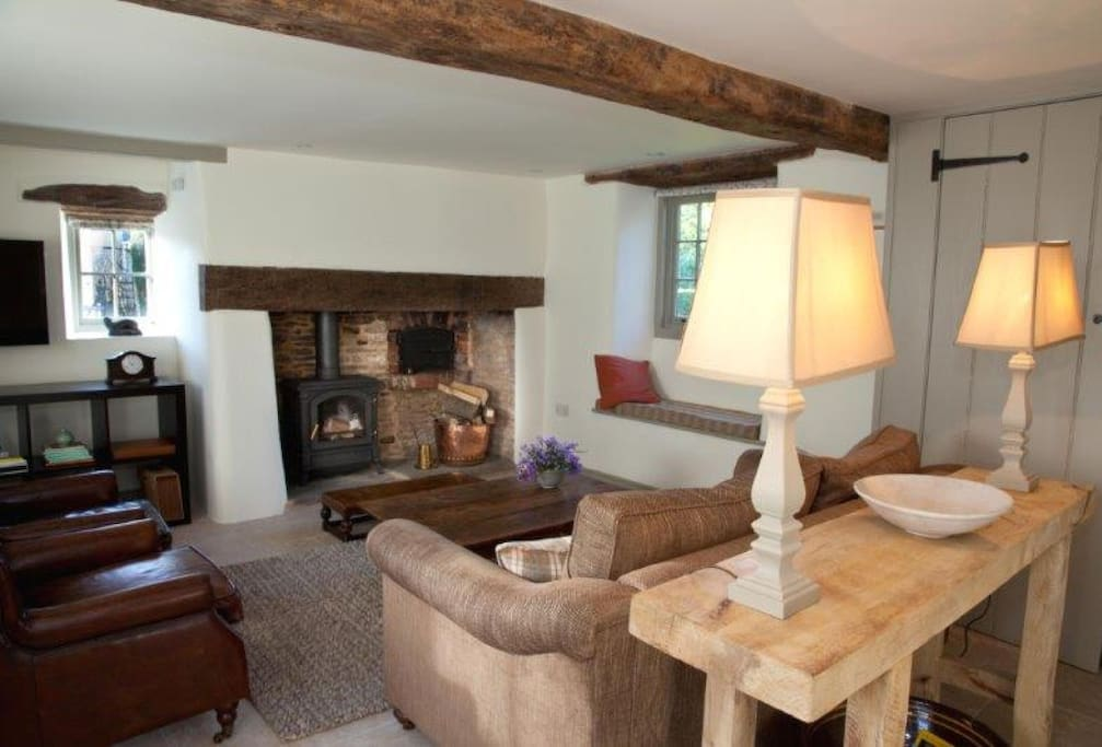 Ground floor:  Open plan, beamed sitting room with wood burning stove