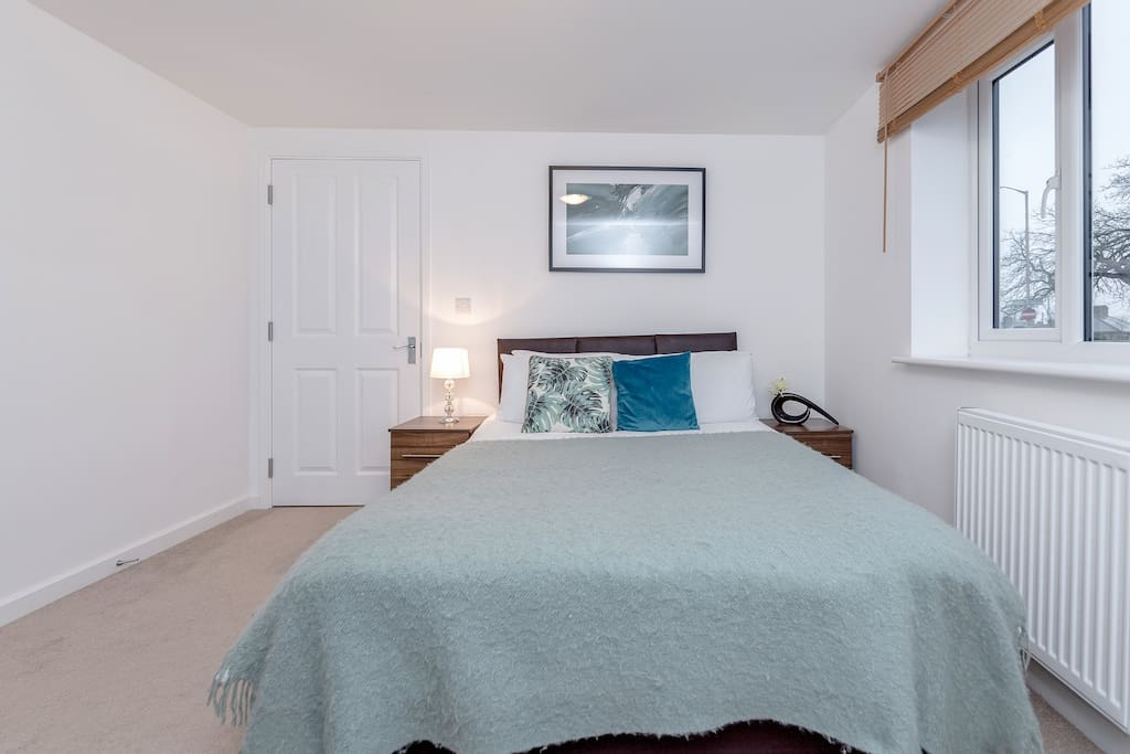 Two bedroom apartment decorated in beautiful Teal - Your home away from home