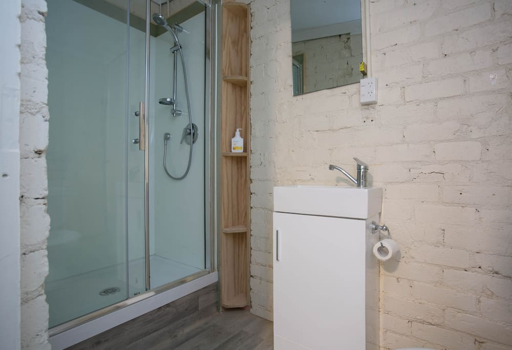 Bathroom with brand new shower