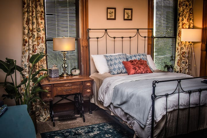 First floor master bedroom with historic double bed
