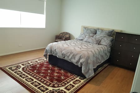 Spacious private bedroom at Caulfield East