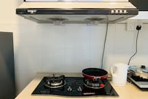 Our kitchen with fridge, induction cooker, pot and fryer pan, electrical kettle, cutlery and etc.