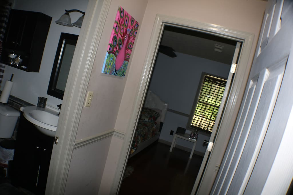 Private hallway with bathroom adjacent to guest room.
