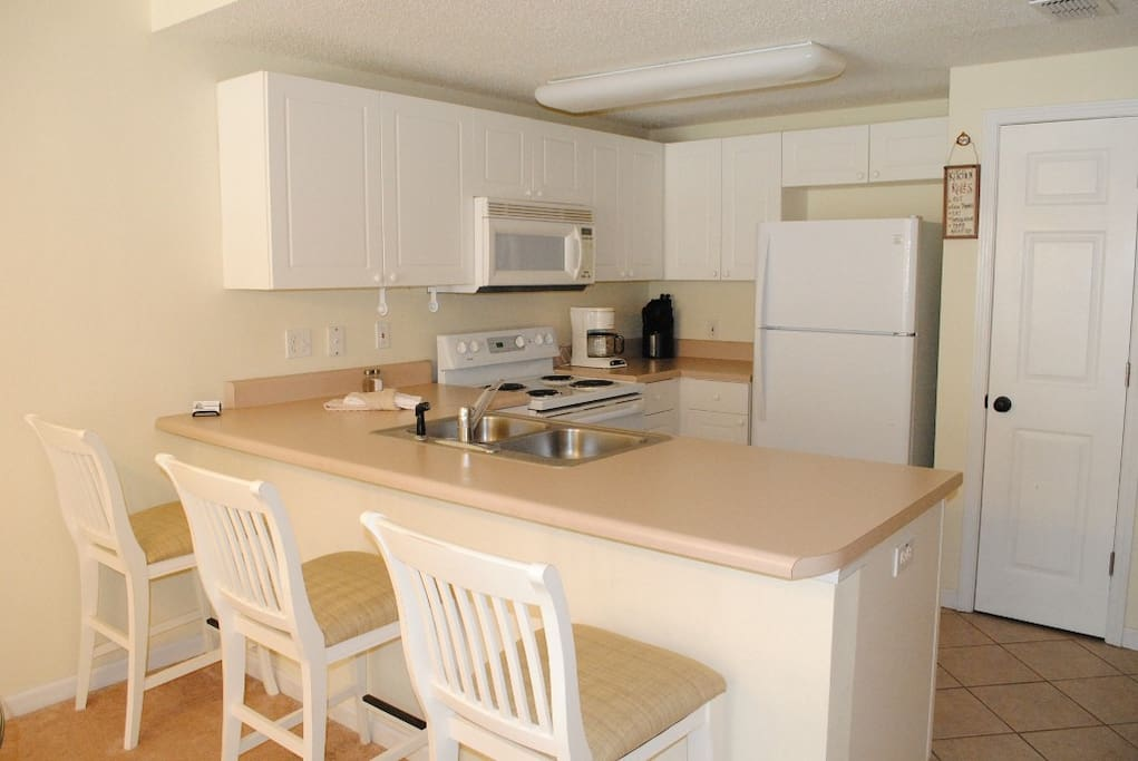 Fully Equipped Kitchen with Snack Bar for your convenience.