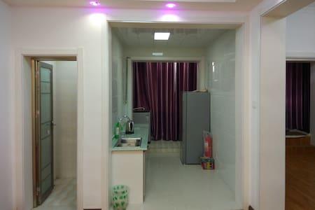 沙洲夜市民宿公寓 - Jiuquan - Hotellipalvelut tarjoava huoneisto