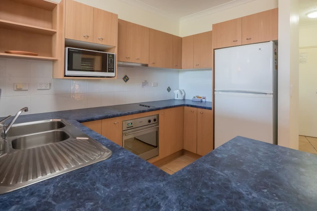 Full functioning kitchen with dishwasher and stove.