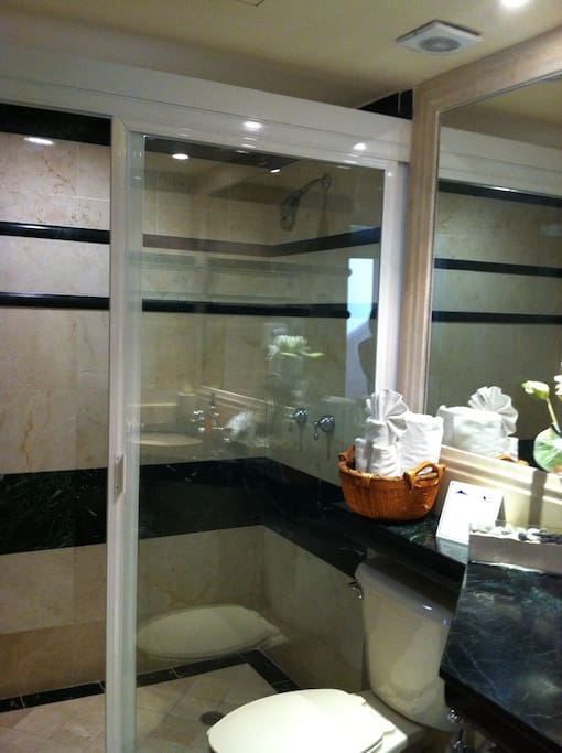 Marble bathroom with a lovely spacious shower