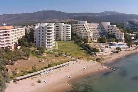 Entire seafront beach apartment with mountain view