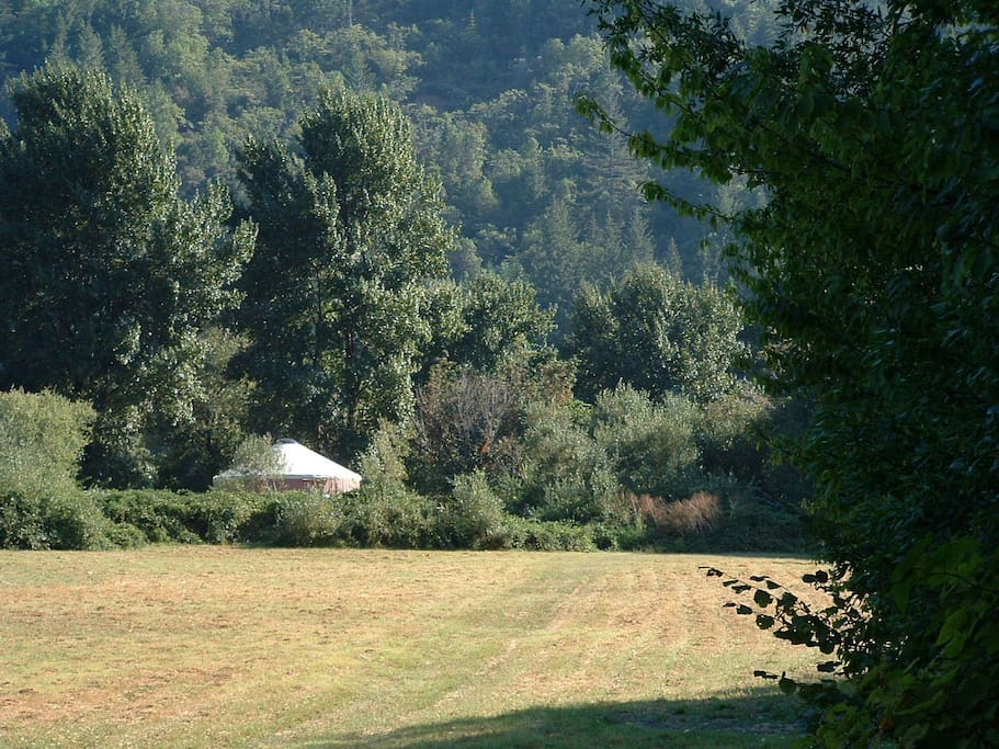 Two story Riverview Yurt across the meadow