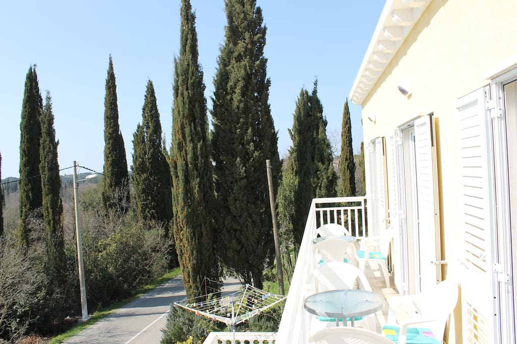 Balcony with view over cypresses
