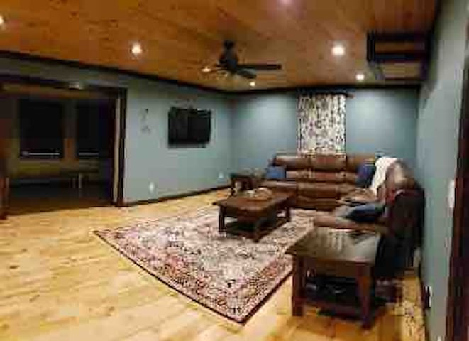 Living Room: Includes a comfy leather sectional with two extra-wide reclining seats, a flat screen TV and DVD player, and assorted board games.  TV is connected to Disney+, Netflix, Amazon Prime Video.
