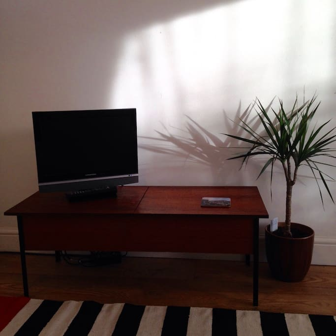 TV with freeview and DVD player, plus selection of DVD's.