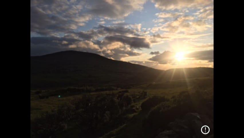 Sun setting behind Slieve Croob - back door view...