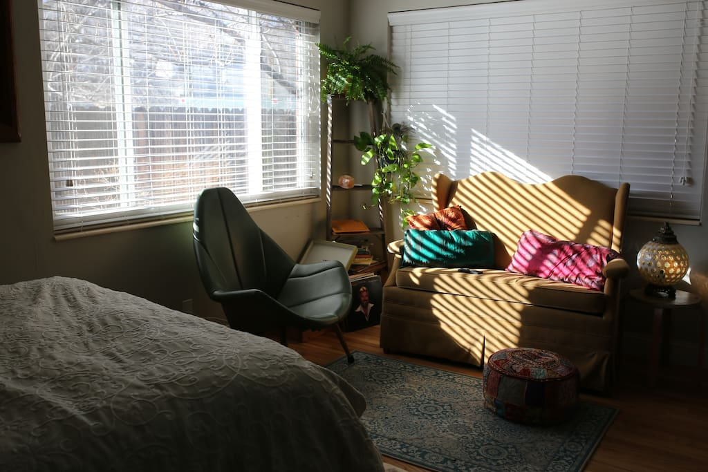 Our cozy retro living space complete with a comfy little sofa and a record player to enjoy our thrifted record collection!