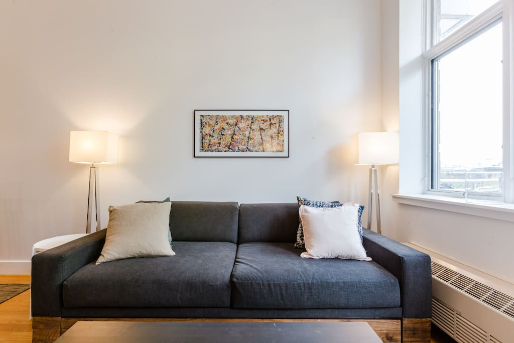 Relax after a long day touring the city in this oversized CB2 couch, that easily concerts to a sleeper sofa!