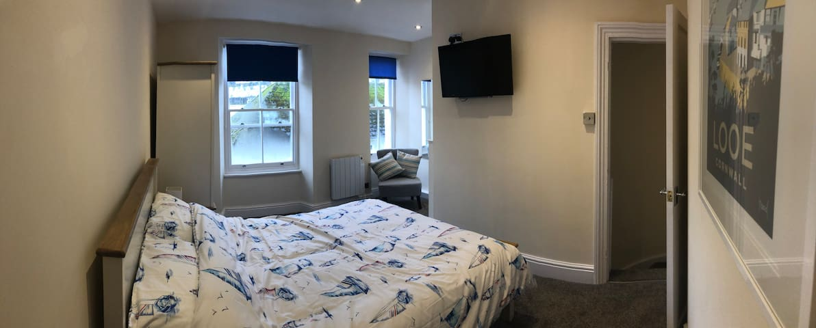 This is the Master Bedroom which has dimmer lights,USB chargers in the plug sockets and a good size tv for an early relaxing night.The radiators are controlled easily for the temperature you require for a cosy nights sleep.