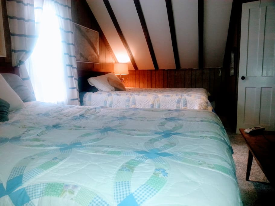 Comfortable room with flat screen TV (Direct TV).  Two queen size beds. Room connects to landing.