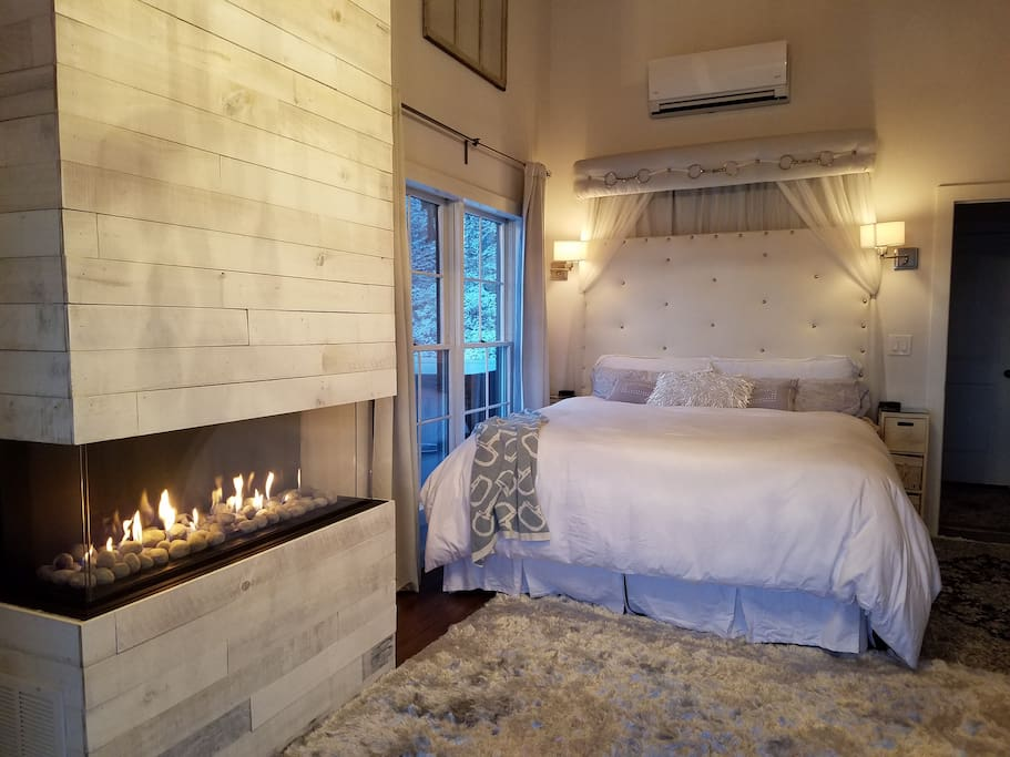 Luxurious king bed, gas fireplace and sliders to the North deck with hot tub