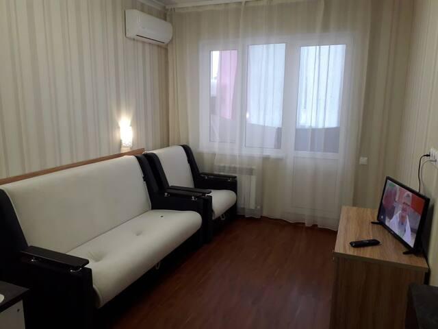 Новый двухместный диван и кресло -кровать.Все раскладывается