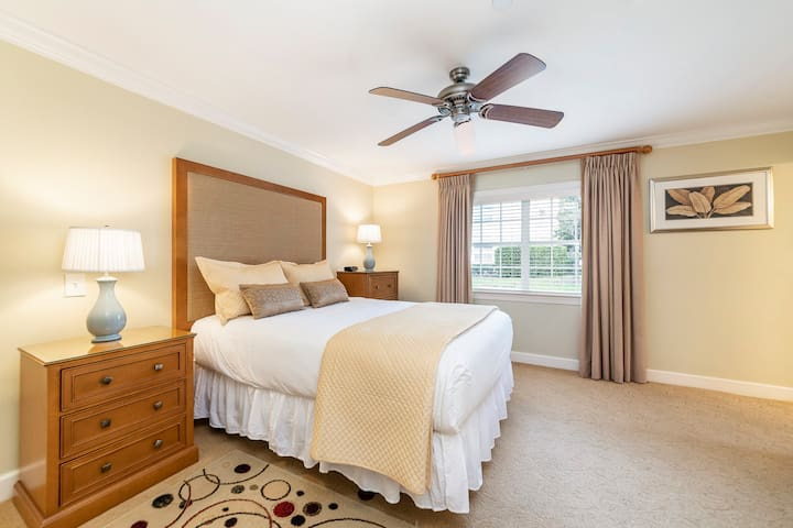 Guest room with queen bed and two night stands.