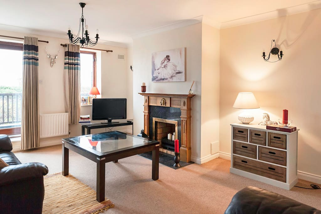 Living room is equipped with two comfy sofas and includes Wi-Fi & Sky TV. There are also books available to read as well as some puzzles. In addition, the balcony just off the living room lends itself to exquisite sunsets over Malahide estuary.