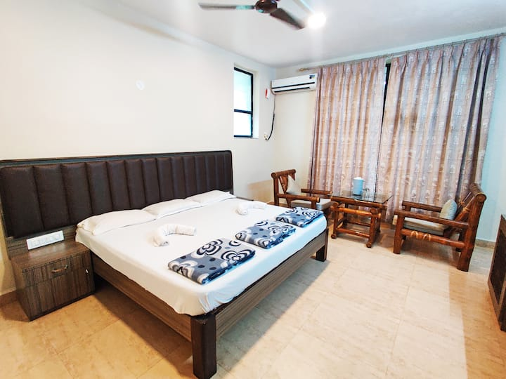 Furnished Room in Lush Greenery with Mountain View