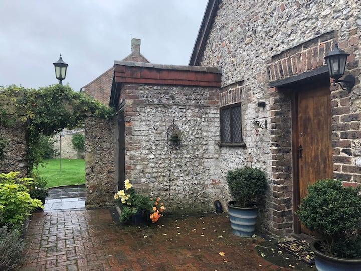 Flint cottage in historic 1066 village.