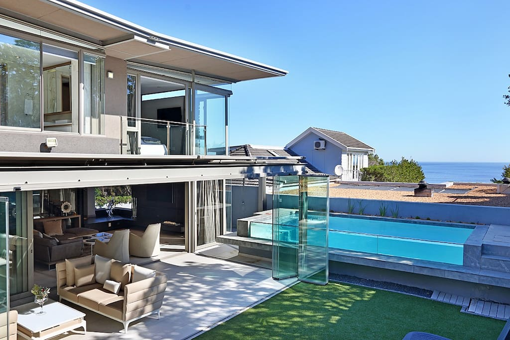 Lounge opens onto sunroom and outdoor pool area