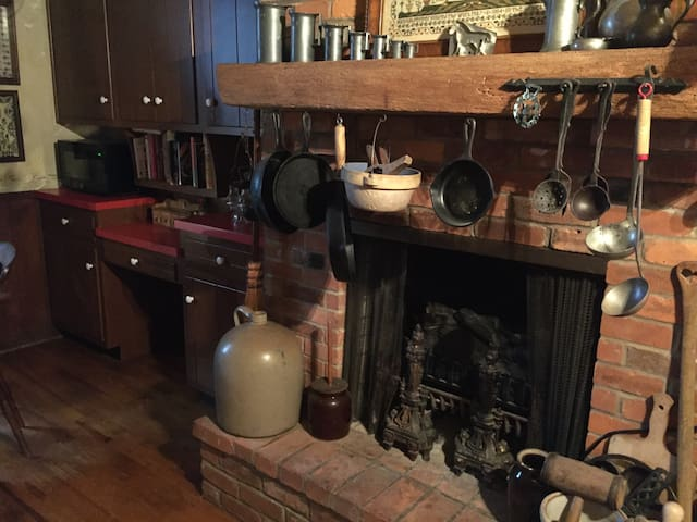 Charming eat-in kitchen with fireplace, double ovens, coffee, equipped with everything you need to cook.